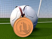 Football and gold medal Royalty Free Stock Photography