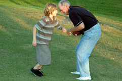 Football with grandpa Royalty Free Stock Images