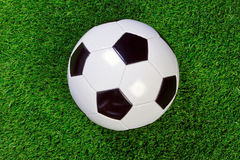 Football on grass Royalty Free Stock Photos