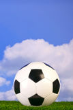 Football on grass Royalty Free Stock Images