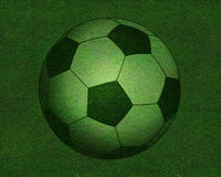 Football on grass field Royalty Free Stock Image
