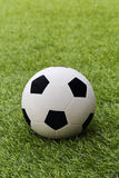 Football on grass field. Football soccer on grass field royalty free stock image