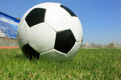 Football. On a grass lawn of sports stadium Royalty Free Stock Image