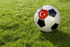 Football with Flag. Football on a grass pitch with Turkey Flag stock photography