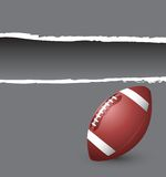 Football on gray ripped banner Royalty Free Stock Image
