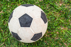 Football  on the green fields. Old soccer ball on a football field Royalty Free Stock Image