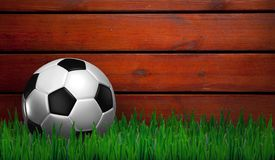 Football on green grass Royalty Free Stock Photography