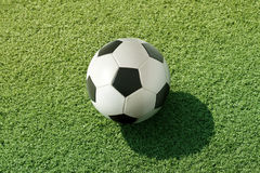 Football on green grass Royalty Free Stock Photos