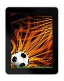 Football in green grass with background in tablet-pc Royalty Free Stock Image