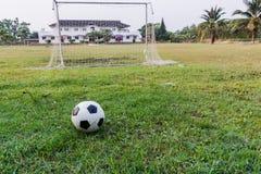 Football on green grass. Stock Photo