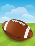 Football on Green Grass. A realistic football laying on a well maintained field. Vector EPS 10 available. EPS file contains transparencies and gradient mesh stock illustration