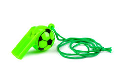 Football whistle. Football green whistle on white stock photography