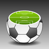Football ground placed on soccer ball. Royalty Free Stock Photography