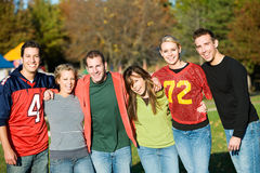 Football: Group of Friends on an Autumn Day Royalty Free Stock Photos
