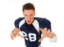Football: Growling Football Player. Caucasian American football player, in uniform, isolated on white, with various related props Royalty Free Stock Photo