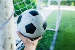 Football on hand in goal area. For goalkeeper Royalty Free Stock Images