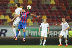 Football heading duel. Between Nicusor Stanciu from Steaua Bucharest and Taras Tsarikayev from FK Aktobe during the qualification match for Uefa Champions stock photos