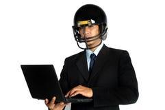 Football-Helm-Griffnotizbuch des Geschäftsmannes amerikanisches Lizenzfreies Stockbild