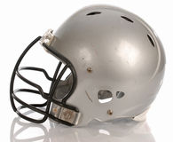 Football helmet. Scratched football helmet with reflection on white background Stock Photos