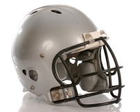 Football helmet. Grey football helmet with reflection on white background Royalty Free Stock Photography