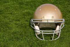 Football Helmet on Artificial Turf Facing Forward Royalty Free Stock Images