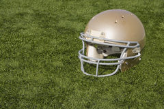 Football Helmet on Artificial Turf Royalty Free Stock Photography