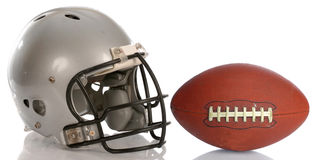 Football helmet and ball. Protective football helmet and leather football with reflection Stock Images