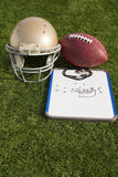 Football Helmet Ball Clipboard and Whistle Portrait Stock Photography