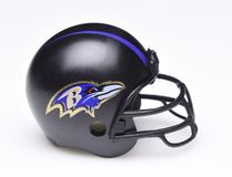 Football Helmet for the Baltimore Ravens. IRVINE, CALIFORNIA - AUGUST 30, 2018: Mini Collectable Football Helmet for the Baltimore Ravens of the American stock images