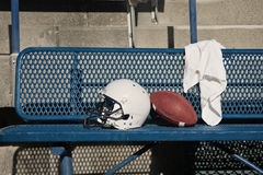 Football Helmet on a bench Royalty Free Stock Images