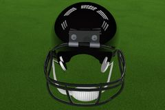 Football Helmet. Black football helmet in the middle of field, with stadium lights, 3d render Stock Image