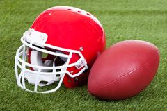 Football Helmet On Field Stock Images