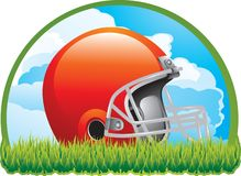 Football helmet on grass during day. Football helmet laying on grass with blue sky background Stock Photos
