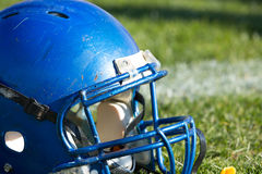 Football helmet. On the grass field Stock Image