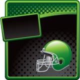 Football helmet on green and black halftone ad Stock Photo