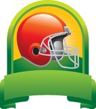 Football helmet in green display Stock Photography