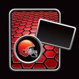 Football helmet on red hexagon banner Stock Photo