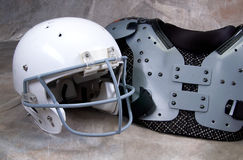 Football helmet and shoulder pads Stock Images