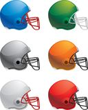 Football Helmets. A variety of different colored football helmets Stock Photos