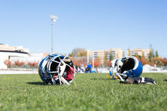 Football helmets. End of a football game with helmets on the ground Royalty Free Stock Photography