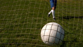 Football hitting the back of the net stock footage