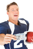 Football: Holding Game Day Tickets. Isolated on white series of a Caucasian American football player Stock Photography