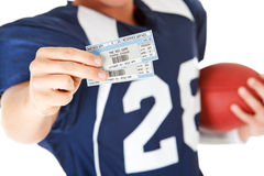 Football: Holding Game Day Tickets. Isolated on white series of a Caucasian American football player stock images