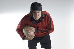 football holding horizontal player rugby Στοκ φωτογραφία με δικαίωμα ελεύθερης χρήσης