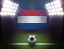 Football with Holland Flag in stadium. Royalty Free Stock Images
