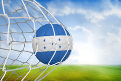 Football in honduras colours at back of net Royalty Free Stock Photo