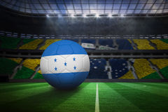 Football in honduras colours. In large football stadium with brasilian fans royalty free illustration