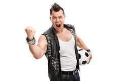 Football hooligan holding a ball and shouting Royalty Free Stock Photography