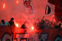 Football hooligans with flares Stock Photography