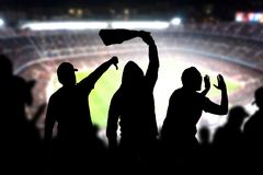 Football hooligans in game. Angry soccer fans. Football hooligans in game. Angry soccer fans shouting and booing in the crowd. Losing team fans got mad. Furious royalty free stock photo